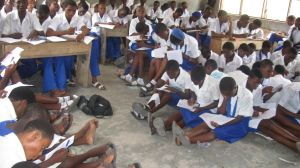 Students writing exams in a Lagos school