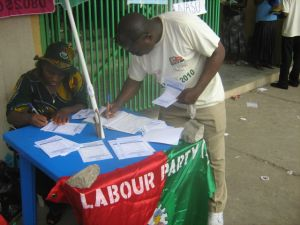 A worker signing to join the Labour Party