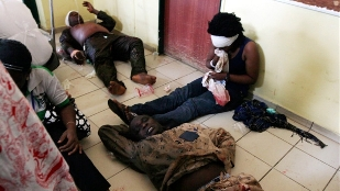 Victims receiving treatment on bare floor at Abuja National Hospital