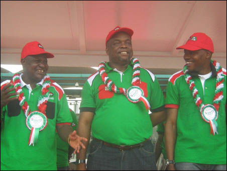2012 May Day - NLC president, left, and TUC president, right, flanked Minister of Labour - photo DSM