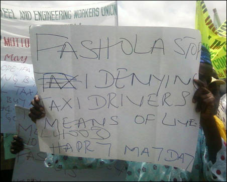 2012 May Day - Taxi drivers with placard at Lagos rally - photo DSM
