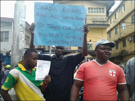 OKADA RIDERS PROTEST BAN AND VICTIMISATION - placard, photo DSM