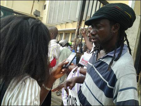 OKADA RIDERS PROTEST BAN AND VICTIMISATION  -  - dagga tolar speaking with media - photo DSM