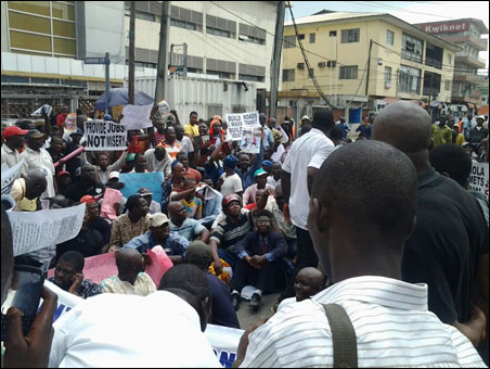 OKADA RIDERS PROTEST BAN AND VICTIMISATION - protesters sitting on the road - photo DSM