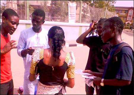 ERC members discussing students while circulating leaflets at Yabatech, photo DSM