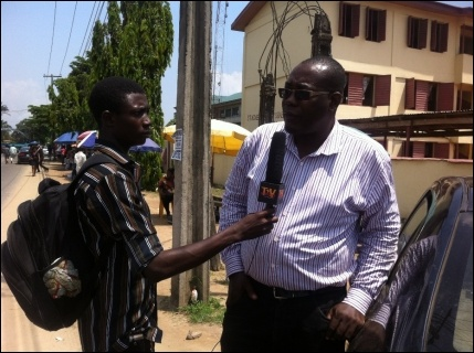 Achike Chude, JAF Deputy Chair, speaking with a journalist at the protest - photo DSM