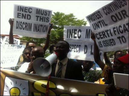 Alfred Adegoke, SPN Legal Adviser, speaking at the demo - photo DSM