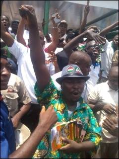 Dimeji Macaulay, DSM member, with protesting workers at Abuja May Day - photo DSM