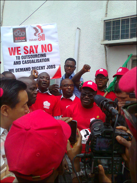 Issa Aremu, NLC Vice President, led the protesters to Durapack, photo by DSM