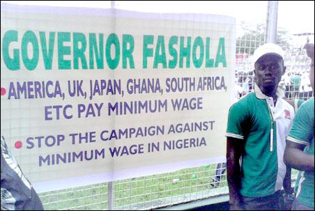 Fashola and Minimum wage banner at 2014 lagos May Day rally, photo by DSM