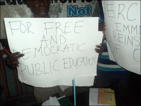 Poster at OAU protest, photo by DSM